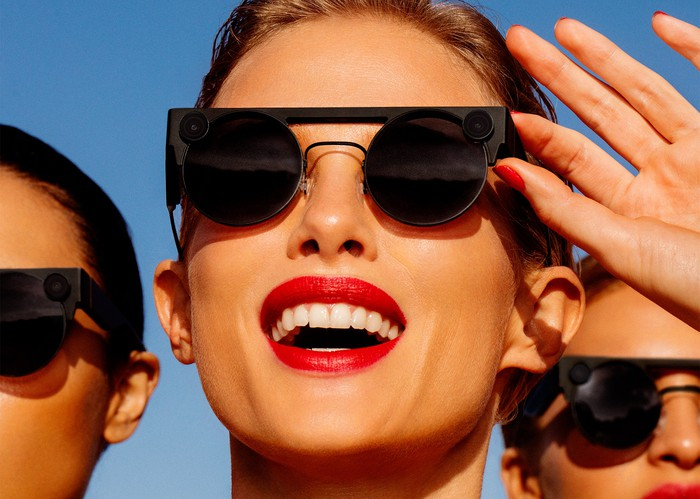 Three people are wearing Snap's Spectacles 3 in an outdoor setting.