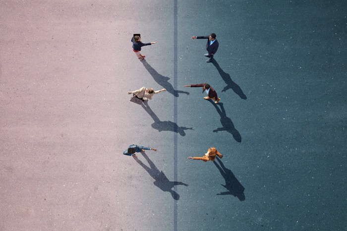 Aerial view of six people about to shake hands.