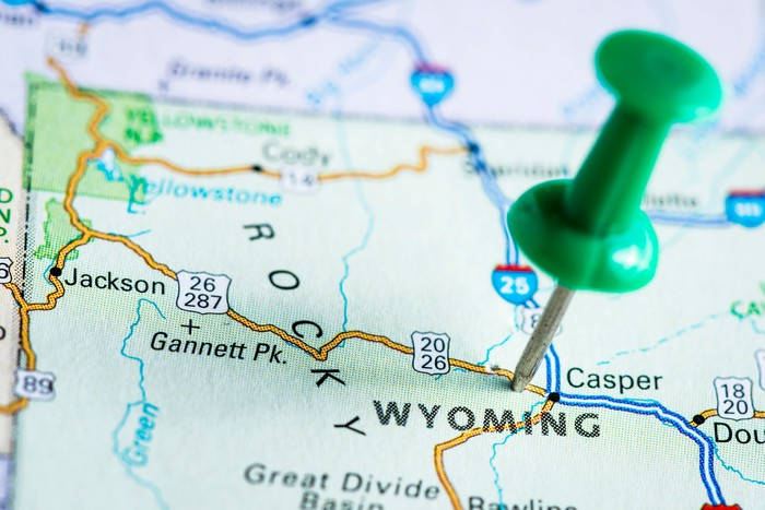 A push pin on a map of Wyoming.
