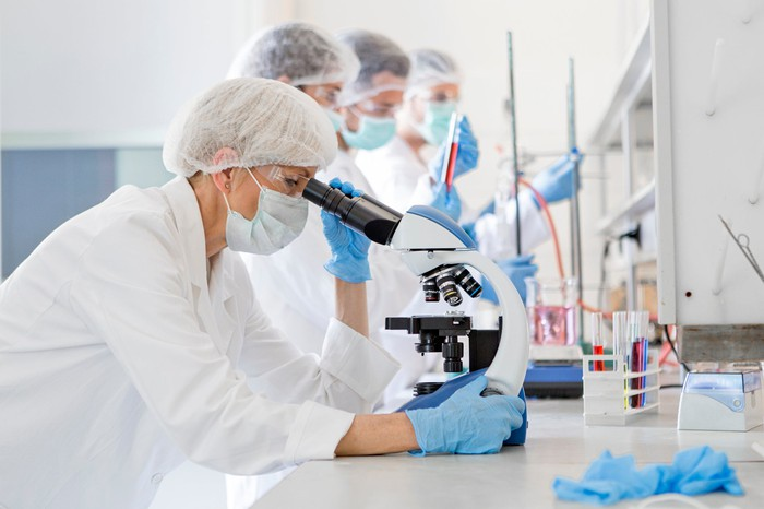Technicians working in a lab.