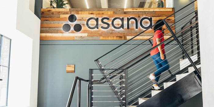 Person walking up stairs at Asana headquarters