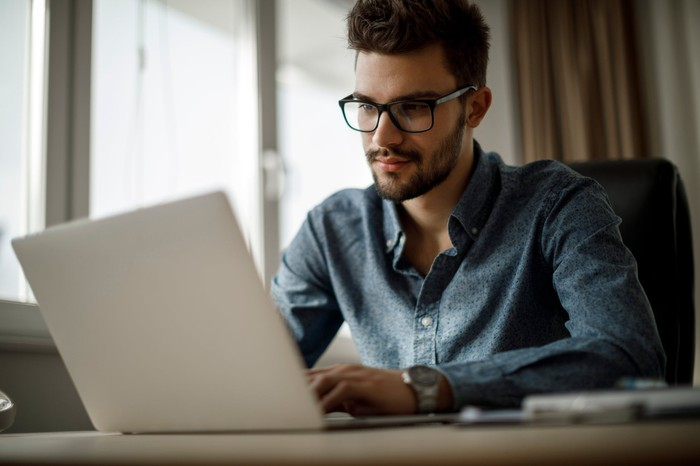 Person sitting at laptop