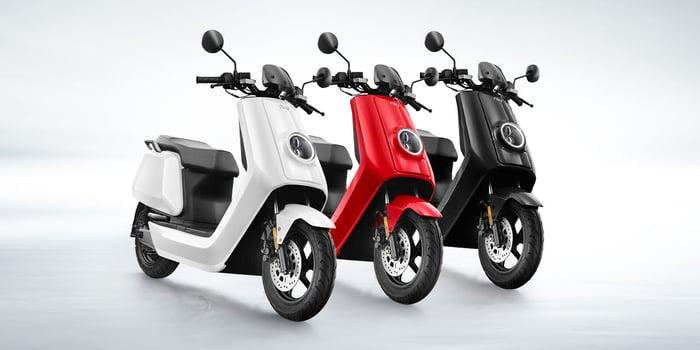 Three Niu electric mopeds.