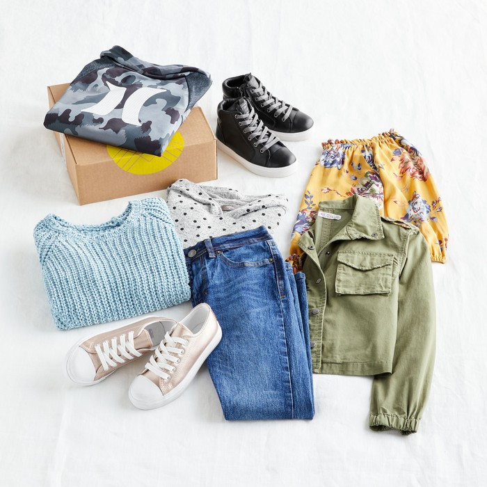 various clothing items from Stitch Fix's spring 2021 collection are arranged on a white background