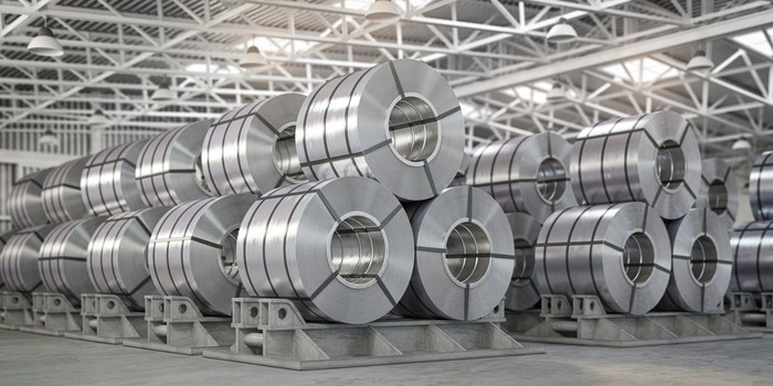 Large galvanized steel parts in factory.