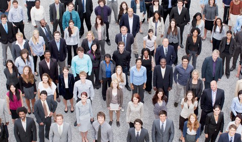 a large diverse crowd of smiling people in business attire businessmen businesswomen businesspeople professionals diversity