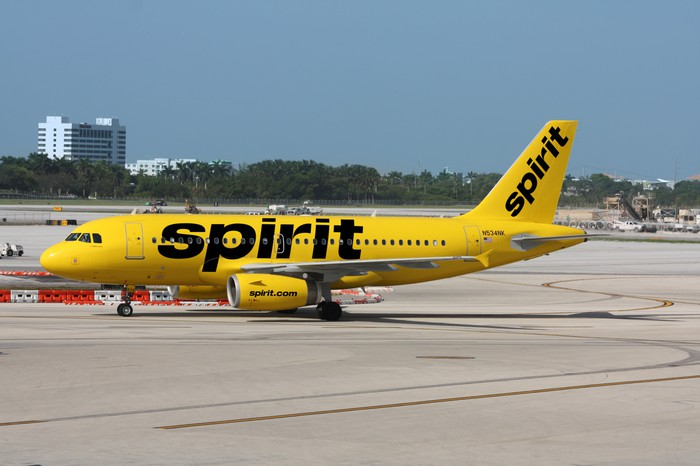 A yellow Spirit Airlines jet on the tarmac.