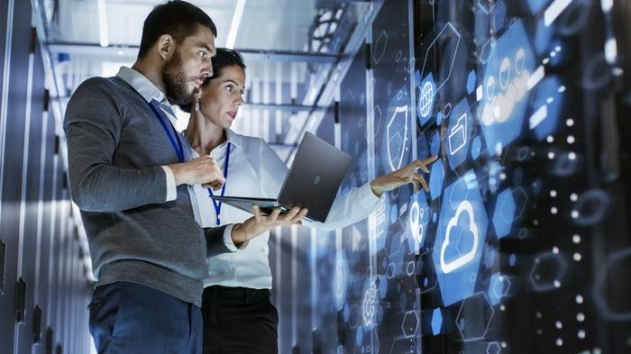 Technicians analyzing a server network.