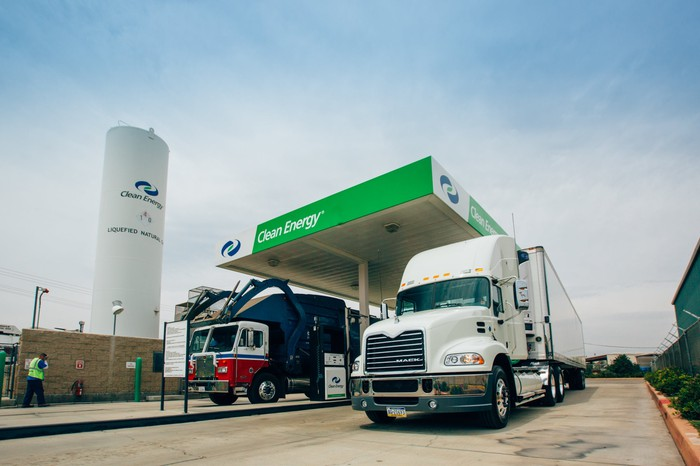 Two trucks at a Clean Energy Fuels station.
