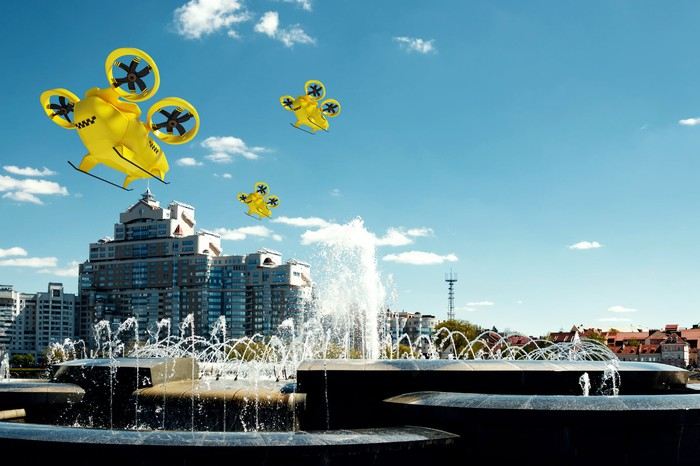Yellow electric air taxis over a cityscape