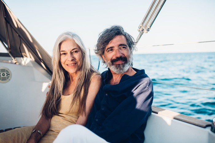 Two people in a boat at sea.