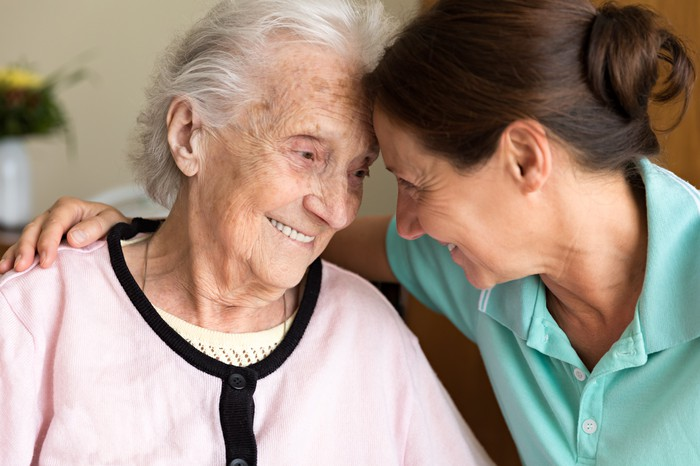 Caregiver helping patient with dementia.