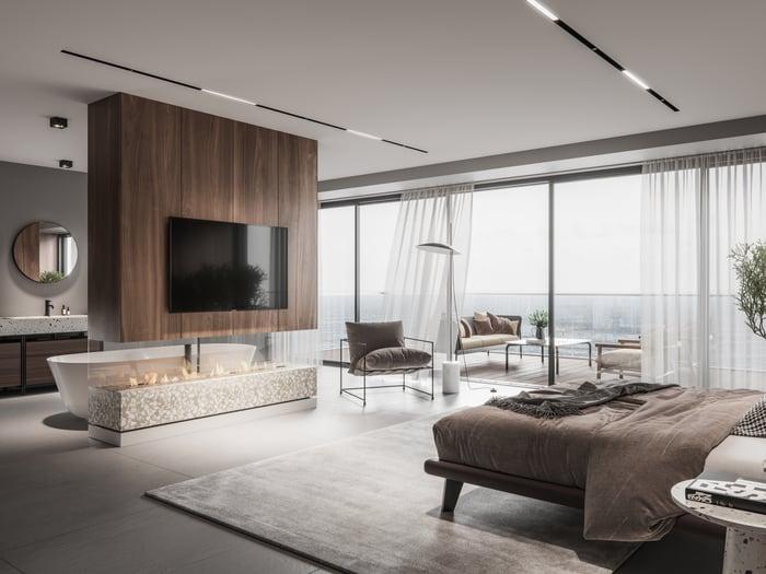 A luxurious bedroom overlooking the ocean.
