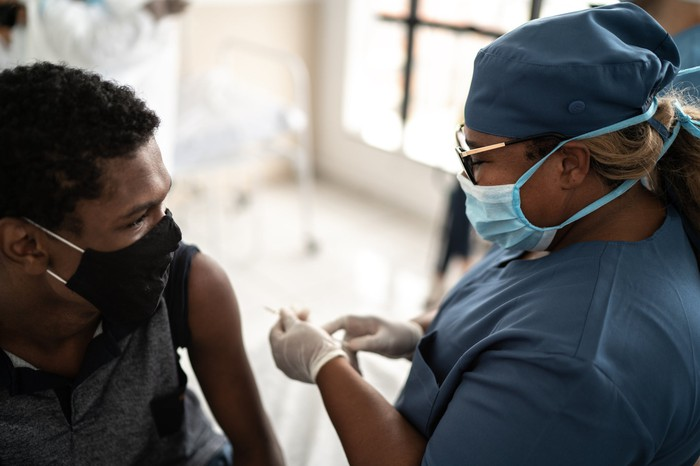 Young man about to receive a vaccine shot.