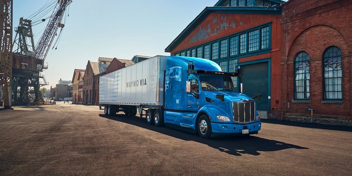 A Waymo truck situated in front of a building.
