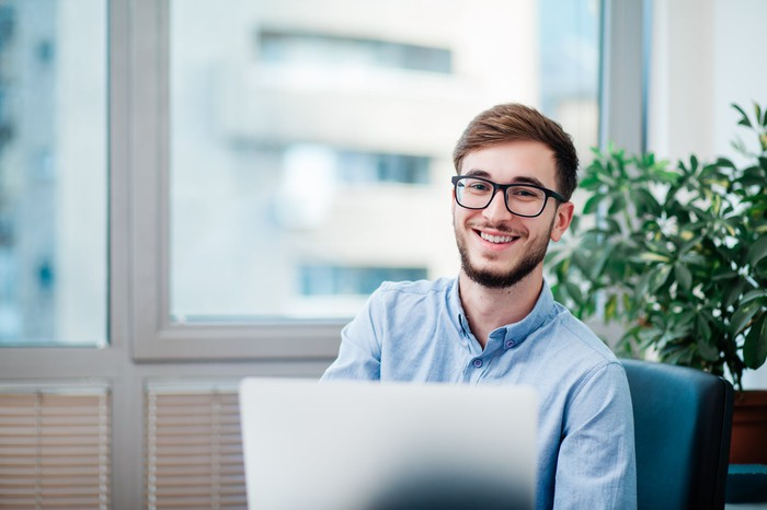 Smiling person at laptop