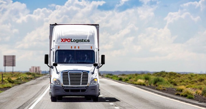 An XPO Logistics semi-trailer truck on the highway.