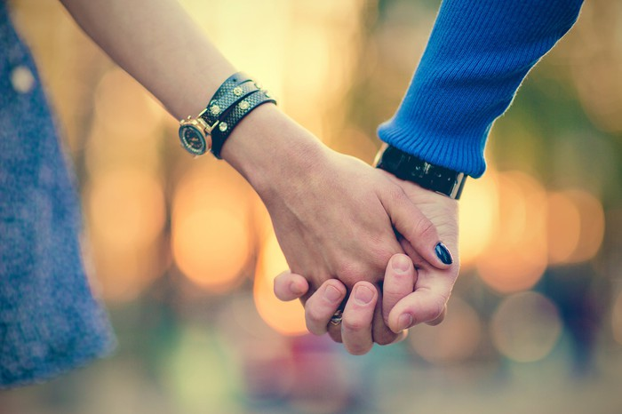 Couple holding hands,
