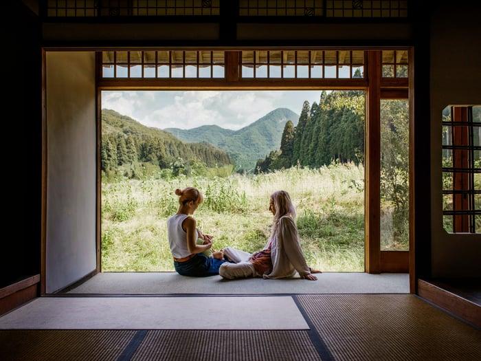 Two people sitting in their Airbnb rental in Japan.