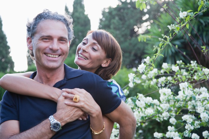 Two people embracing in garden
