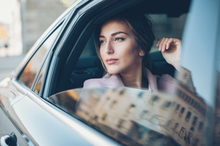 Woman looking out of car window.