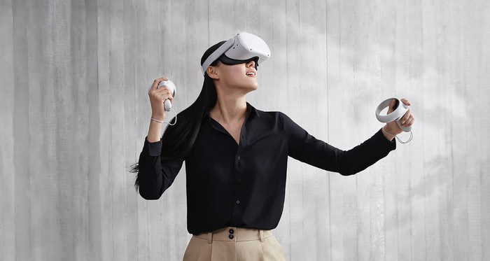 A young woman wearing Facebook's Oculus Quest 2 headset.