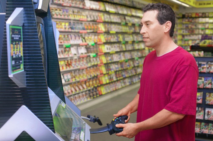 Man playing video game in store