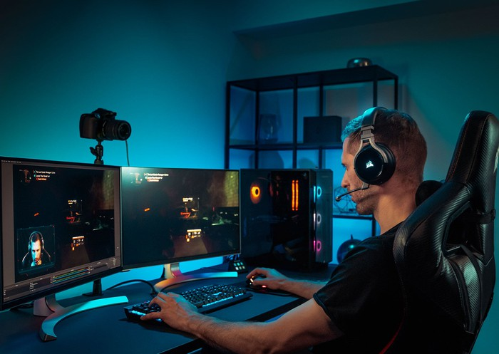 Playing games on a PC with three screens.