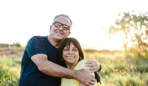 Two people embracing outdoors_GettyImages-1265607076