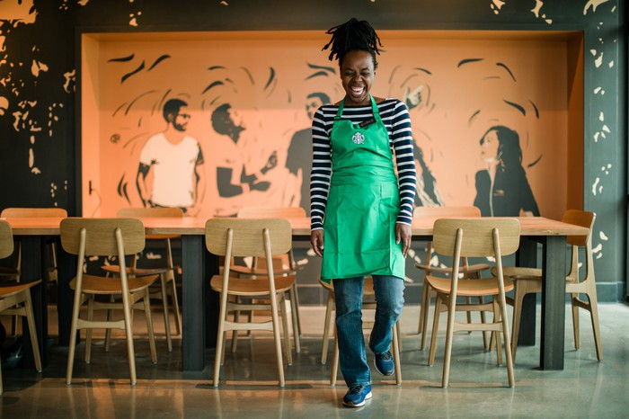 A Starbucks worker in a store.