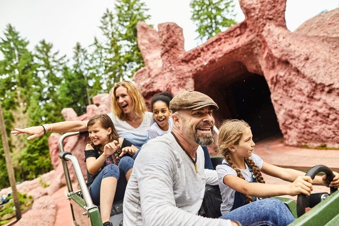 A family on a ride at a theme park.