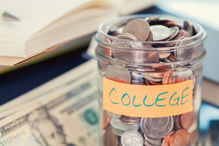 A glass jar used to accumulate college-savings.