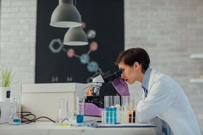 Scientist analyzing samples in a research lab.
