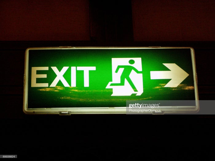 Green Exit sign with arrow pointing the way.