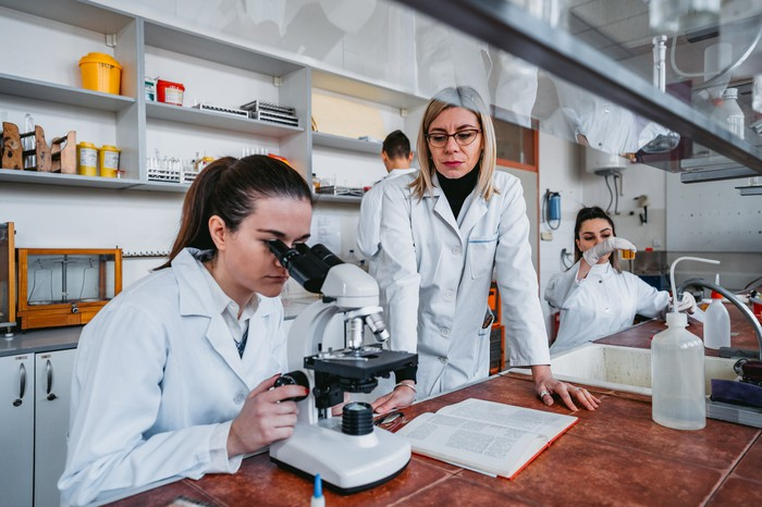 Three scientists working in a medical laboratory.