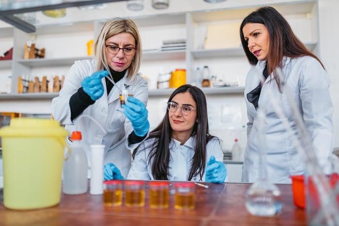 Three scientists in a laboratory.