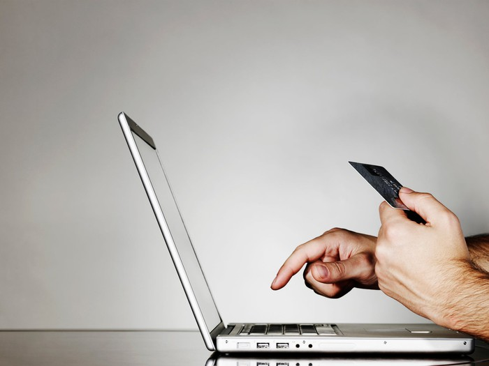 A person shopping online on a computer.