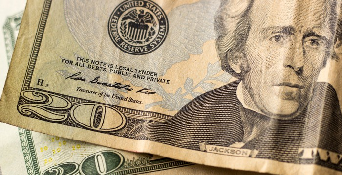 Close-up photo of a couple of twenty-dollar bills.