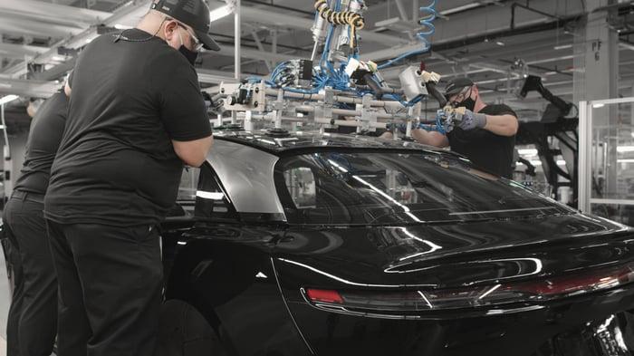 Workers assembling a Lucid Air sedan
