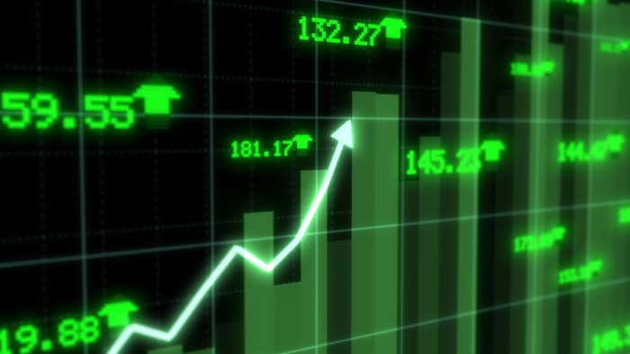 Green stock chart with arrow shooting higher.