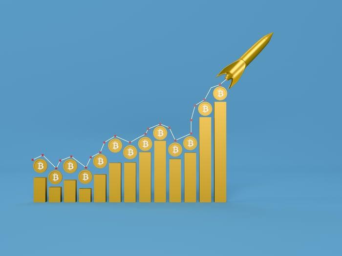 Bitcoin chart with a rocket moving upward.