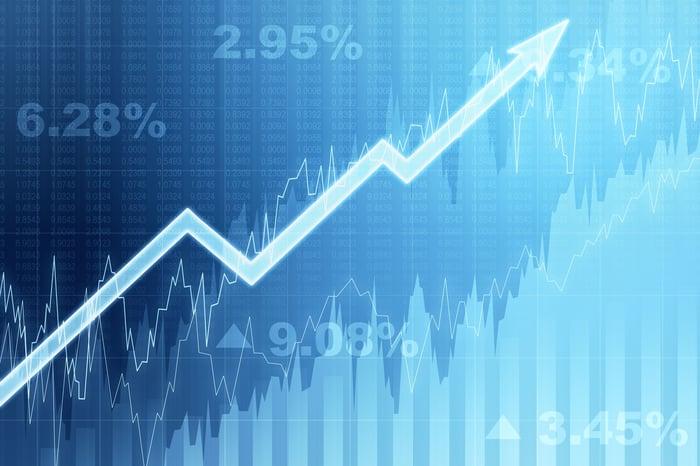 Un graphique avec une flèche pointant vers le haut sur un fond bleu.