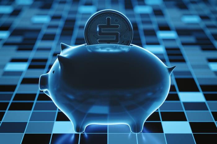 Digital token sliding into a piggybank.