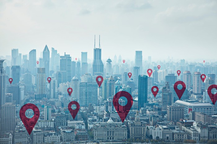 The Shanghai skyline with location indicators over it