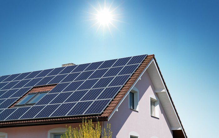 Home with large solar panel installation on the roof.