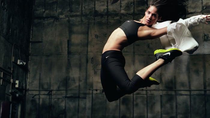 A dancer in Nike gear in mid-air.