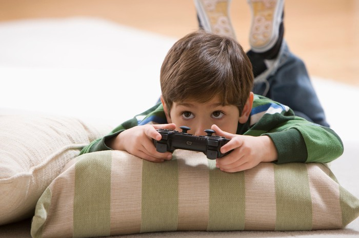 Young child playing a video game.