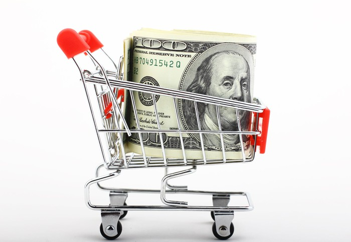 U.S. currency packed into a scale model of a shopping cart.