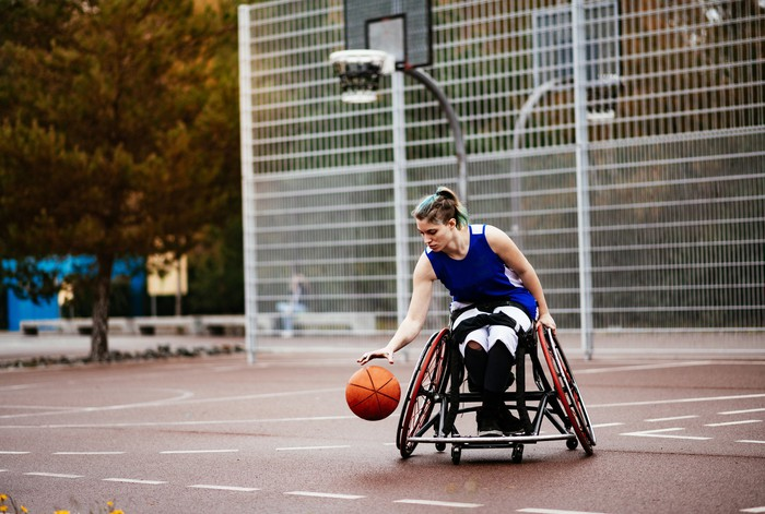 Person in wheelchair playing basketball.