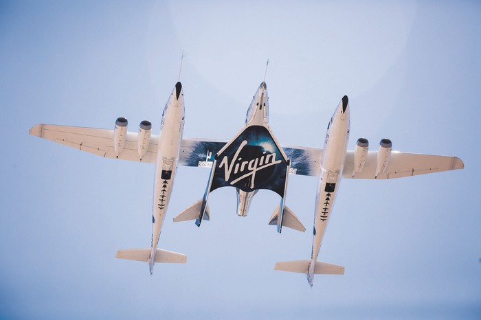 Virgin Galactic's Unity spacecraft tethered to its mother ship.